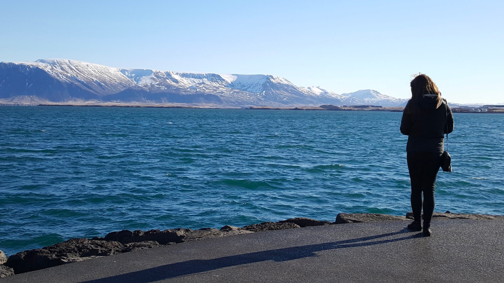 Girl standing on waterfront in Reyklavik, Iceland
